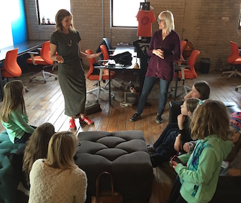 Mary Fallon (left) and Dori Graf talking to 11-year-olds about business,